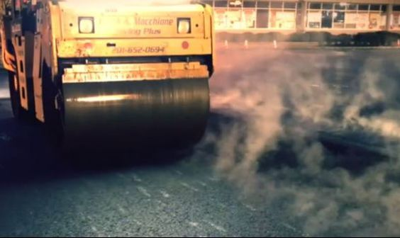 Rolling Asphalt while Hot on Parking Lot VA Beach Paving Pros VA Beach, VA